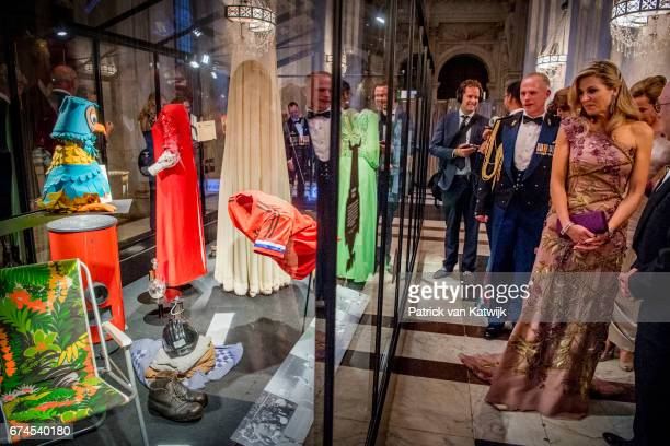 Queen Maxima of The Netherlands shows guests around the exhibition after the dinner for 150 Dutch people to celebrate King WillemAlexander's 50th...