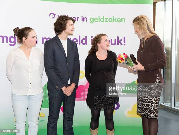 Queen Maxima of The Netherlands talks with young actors during an evening with parents discussing financial education at elementary school The...