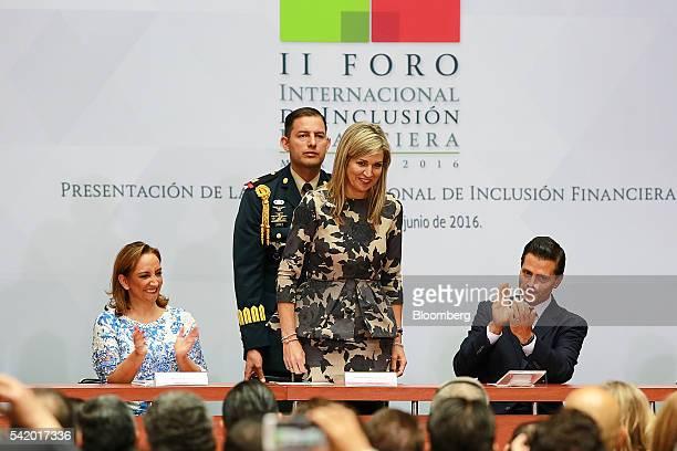 Queen Maxima of the Netherlands UN secretary generals special advocate for inclusive finance for development center stands as Enrique Pena Nieto...