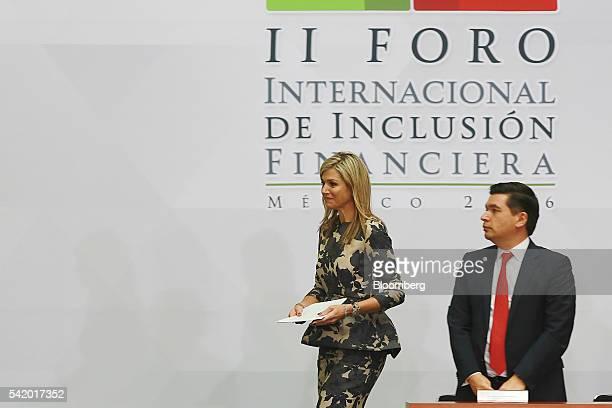 Queen Maxima of the Netherlands UN secretary generals special advocate for inclusive finance for development left walks past Fernando Aportela...