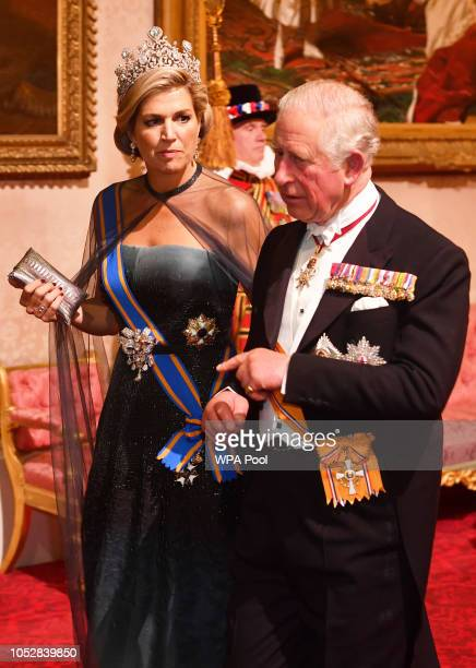 Queen Maxima of The Netherlands walks with Prince Charles Prince of Wales during a State Banquet at Buckingham Palace on October 23 2018 in London...