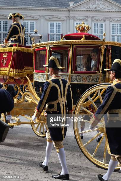 Queen Maxima of the Netherlands waves from the Glass Carriage as she and King WillemAlexander depart Palace Noordeinde on September 19 2017 in The...