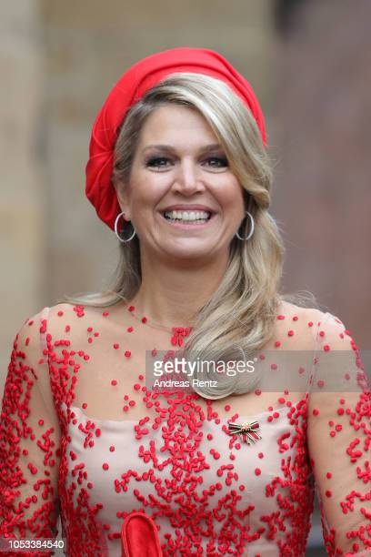 Queen Maxima of The Netherlands waves on her departure at the High Cathedral of Saint Peter in Trier on October 11, 2018 in Trier, Germany. King...