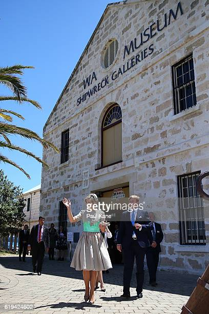 Queen Maxima of the Netherlands waves to well wishers with King Willem-Alexander while departing the Shipwreck Gallaries on October 31, 2016 in...