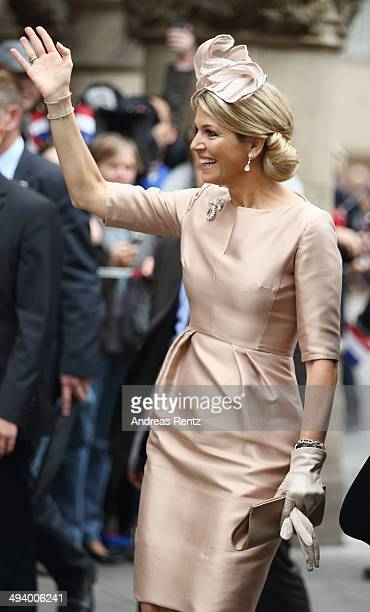 Queen Maxima of The Netherlands waves upon her arrival at 'Haus der Niederlande' on May 27 2014 in Muenster Germany The Royal couple is on a twoday...