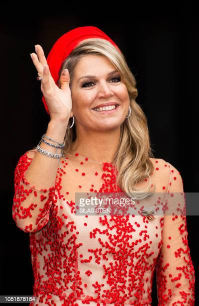 Queen Maxima of the Netherlands waves wellwishers from the Cathedral place in Trier during a three day visit to Germany, on October 11, 2018. /...