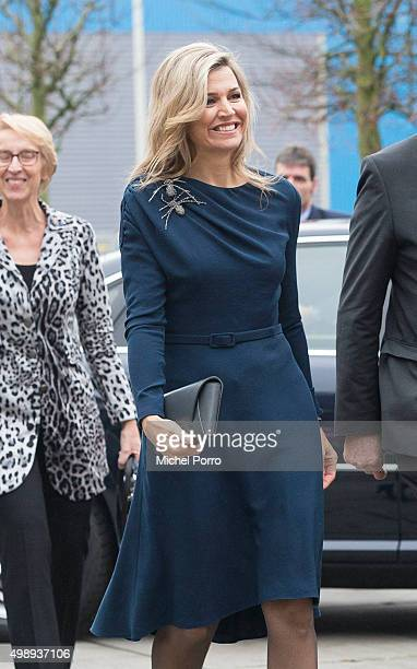 Queen Maxima of The Netherlands wearing a dress by Danish designer Claes Iversen arrives for the 'Kracht On Tour' Financial support workshops for...