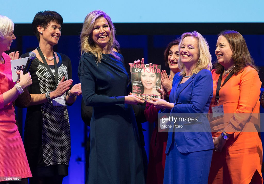 Queen Maxima of The Netherlands (L) wearing a dress by Danish designer Claes Iversen receives the first copy of the Kracht on Tour Magazine from Education Minister Jet Bussemaker (R) during the 'Kracht On Tour' financial support workshops for women at the Fokker Terminal on November 27, 2015 in The Hague Netherlands. The workshops deal with financial independence for women and encourage women to grab more chances to use their talents on the work floor