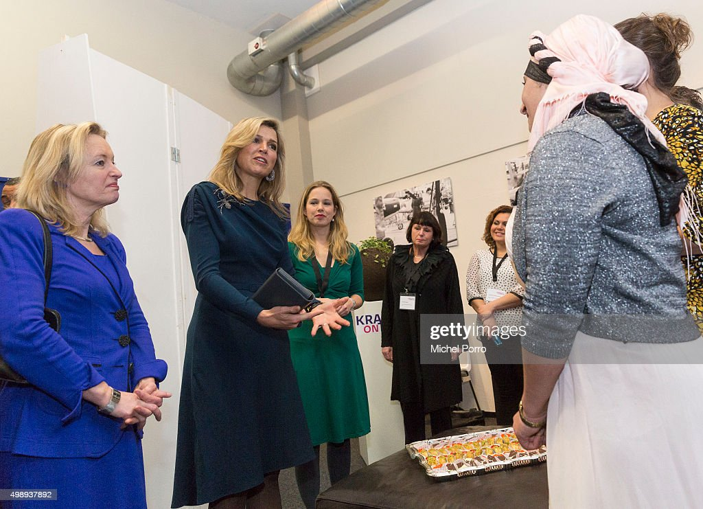 Queen Maxima of The Netherlands wearing a dress by Danish designer Claes Iversen and Education Minister Jet Bussemaker (L) meets women during the 'Kracht On Tour' financial support workshops for women at the Fokker Terminal on November 27, 2015 in The Hague, Netherlands. The workshops deal with financial independence for women and encourage women to grab more chances to use their talents on the work floor