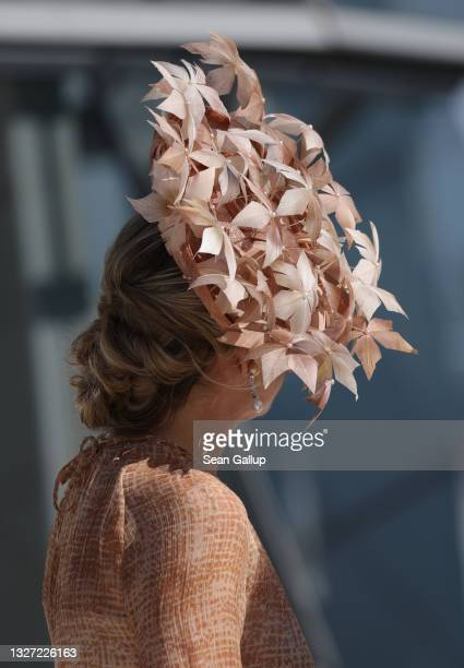Queen Maxima of the Netherlands wears a leafy hat as she and King Willem-Alexander visit the cupola of the Reichstag on July 06, 2021 in Berlin,...
