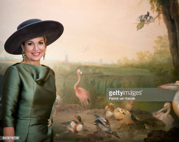 Queen Maxima of The Netherlands who opens the exhibition Royal Paradise Aert Schulman and the imagination of nature looks at wallpaper from her...