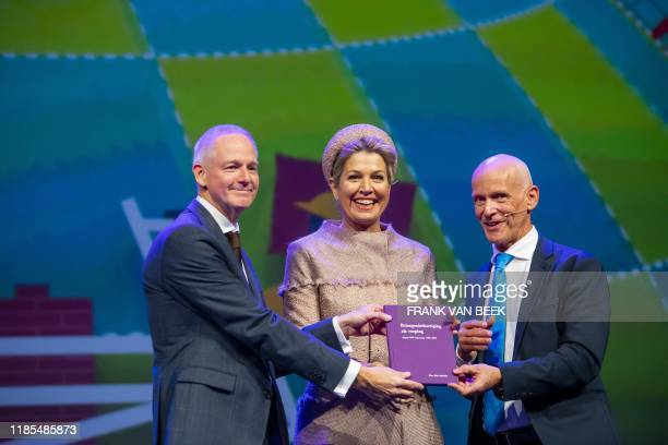 Queen Maxima receives the jubilee book Representation of Interests from Piet Fortuin and Johan Slok during the anniversary conference of CNV...