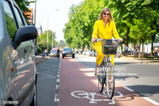Queen Maxima rides a bike to visit the Kunstmuseum Den Haag on June 2, 2020 in The Hague, Netherlands. The museum has re-opened after being closed...