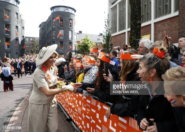 Queen Maxima shakes hands during a visit to Amersfoort on Kings Day on April 27 2019 The king celebrates his birthday in the city in central...