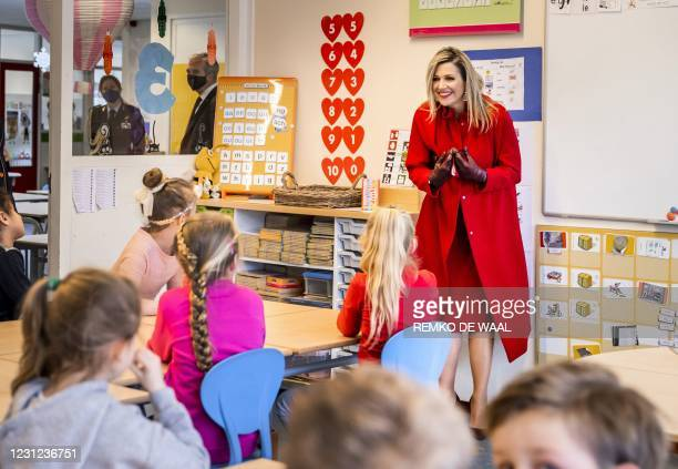 Queen Maxima smiles to children during a working visit to the Christian Primary School Sabina van Egmond in Oud-Beijerland, on February 18, 2021. -...