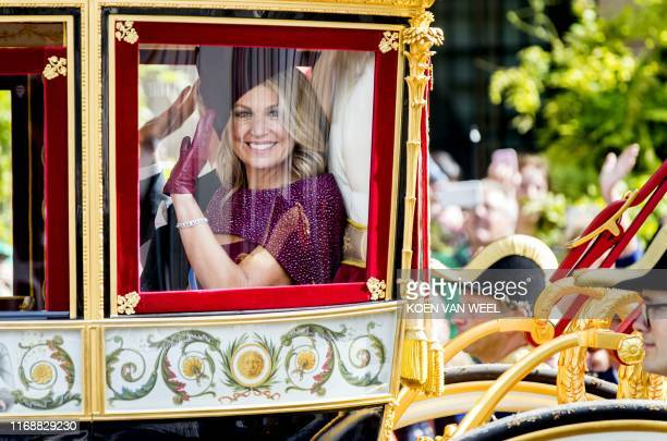 Queen Maxima waves to bystanders from the glass carriage on the way back to Noordeinde Palace on Prinsjesdag in The Hague on September 17, 2019 on...