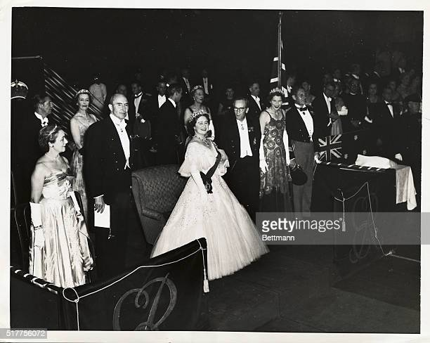 Queen Mother honored at Ball A gracious Queen Mother Elizabeth attired in a white gown acknowledge Plaudits of the guests upon arriving at the...