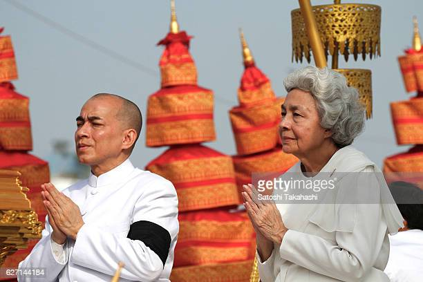Queen Mother Norodom Monineath Sihanouk and King Norodom Sihamoni attend the royal cremation ceremony of the late King Norodom Sihanouk in front of...
