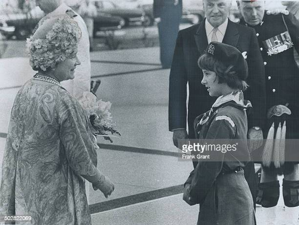 Queen Mother received a bouquet from girl Guide Frances Leamrent daughter of Col J D Leamrent commanding officer of the Toronto Scottish Regiment of...
