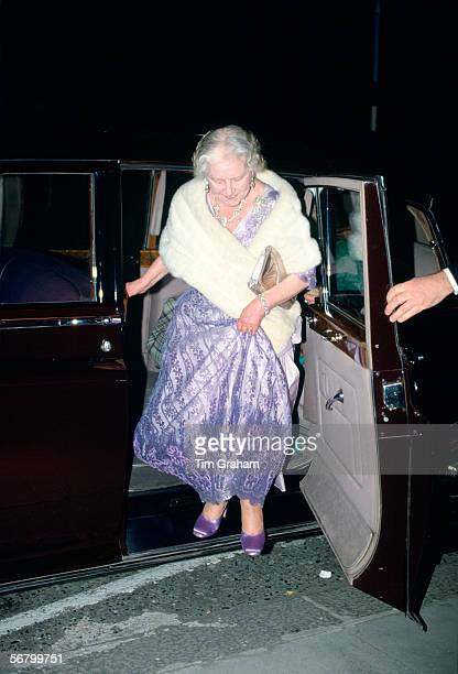 Queen Mother stepping out from Rolls Royce limousine car arriving for a soiree at the Royal College of Music