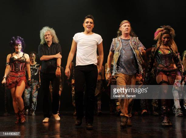 Queen musician Brian May bows with cast members including Sarah French, Noel Sullivan, Kevin Kennedy and Rachel John at the curtain call during the...