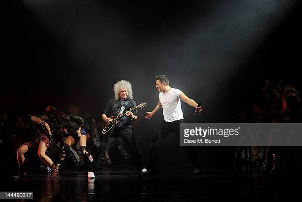 Queen musician Brian May performs with cast member Noel Sullivan during the We Will Rock You 10 Year Anniversary Celebration performance at The...