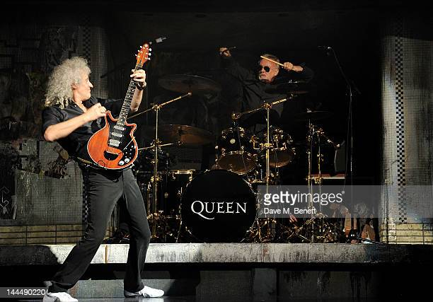 Queen musicians Brian May and Roger Taylor perform during the We Will Rock You 10 Year Anniversary Celebration performance at The Dominion Theatre on...