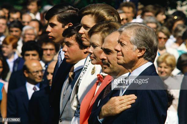 Queen Noor King Hussein and the Jordan princes Abdullah and Faisal join President Jimmy Carter and First Lady Rosalynn Carter at a White House...