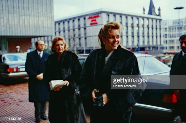 Queen Noor of Jordan before entering Cologne cathedral, Germany, 1988.