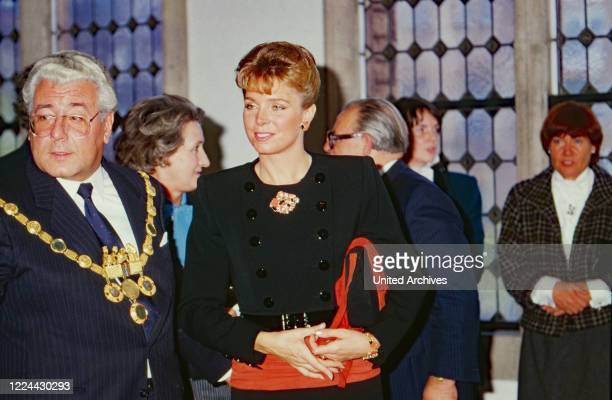 Queen Noor of Jordan gets a warm welcome at Cologne city hall by mayor Norbert Burger, Germany, 1988.