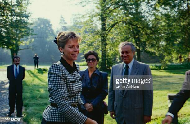 Queen Noor of Jordan in the gardens of Bruehl castle, Germany, 1988.