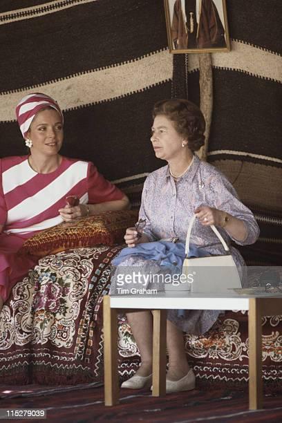 Queen Noor of Jordan sitting with Queen Elizabeth II in a Bedouin tent in Petra while on a state visit to Jordan in March 1984