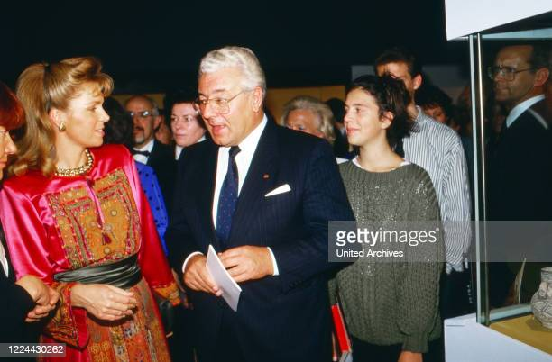 Queen Noor of Jordan visiting an exhibition at Cologne with mayor Norbert Burger, Germany, 1988.