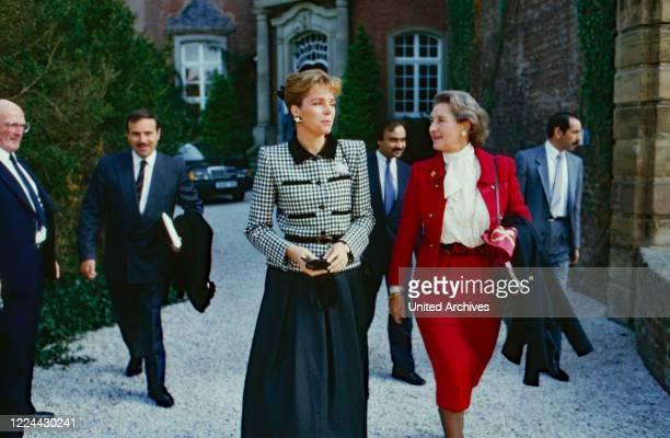 Queen Noor of Jordan with her translator in front of Bruehl castle, Germany, 1988.