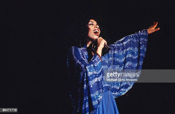 'Queen of Disco' Donna Summer performs onstage in a shimmering blue dress in circa 1978