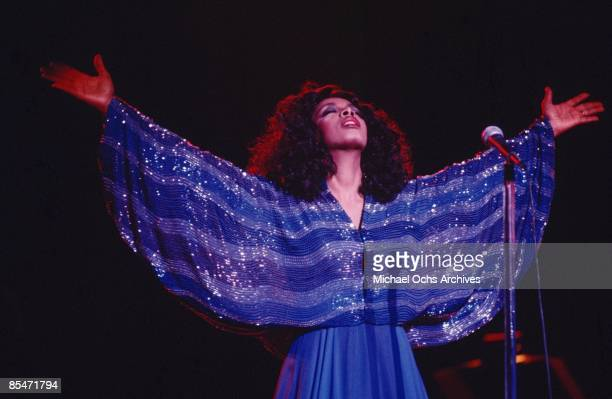 'Queen of Disco' Donna Summer performs onstage in a shimmering blue dress in circa 1979