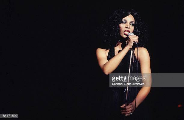 'Queen of Disco' Donna Summer performs onstage in a slinky black dress at the Civic Center on March 26 1978 in Atlanta Georgia