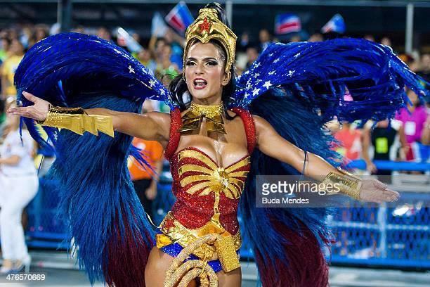 Queen of Percussion Bruna Bruno of Uniao da Ilha Samba School performs during its parade at 2014 Brazilian Carnival at Sapucai Sambadrome on March 03...