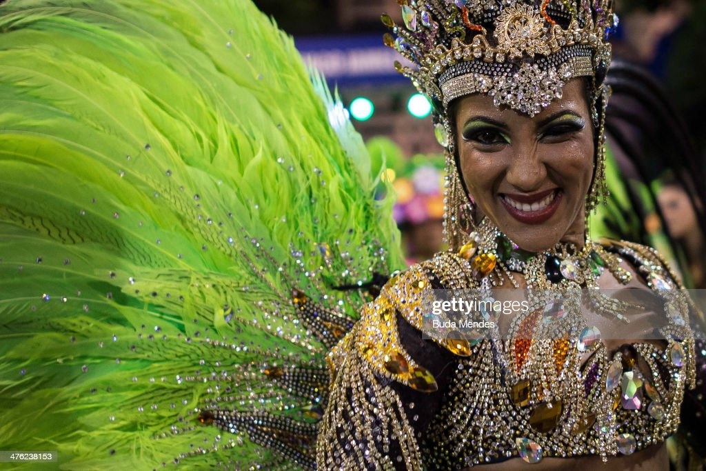 Queen of Percussion Laynara Teles of Imperio da Tijuca Samba School celebrates during the 2014 Brazilian Carnival at Sapucai Sambadrome on March 02, 2014 in Rio de Janeiro, Brazil. Rio's two nights of Carnival parades begin on March 2 in a burst of fireworks and to the cheers of thousands of tourists and locals who have previously enjoyed street celebrations (known as 'blocos de rua') all around the city.