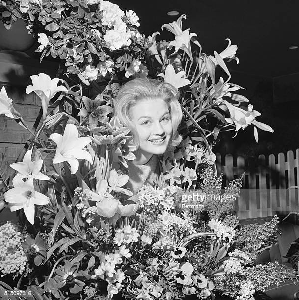 Queen of the Posies New York Diane Sawyer of Louisville Ky queen of the 47th International Flower Show poses with some of her subjects as she appears...