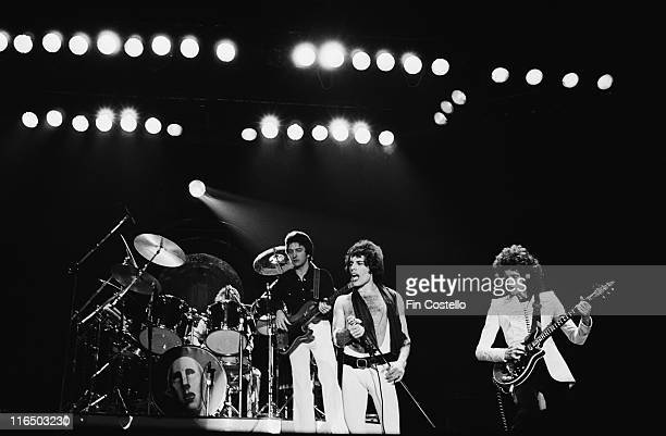 drummer Roger Taylor bassist John Deacon singer Freddie Mercury and guitarist Brian May onstage during a live concert performance by the band at Ahoy...