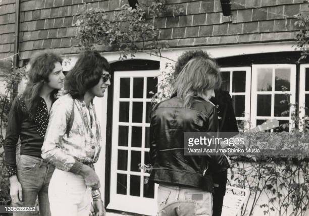Queen outside Ridge Farm Studio during the recording of their album 'A Night At The Opera', Surrey, United Kingdom, 14th July 1975. John Deacon,...