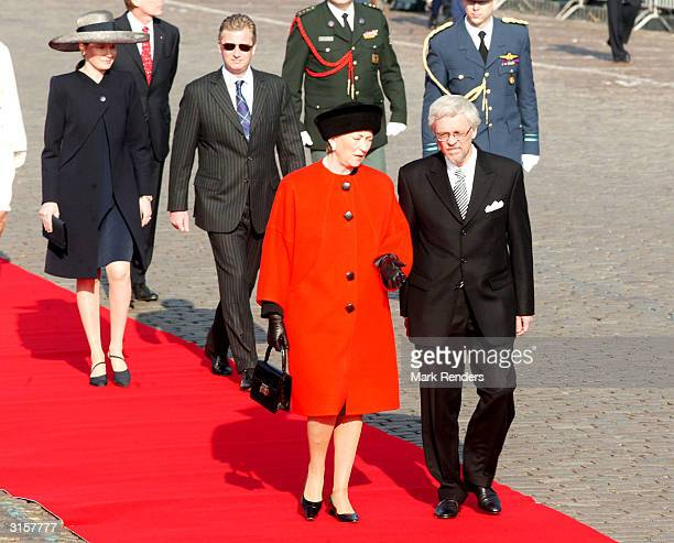 Queen Paola and husband Dr Arajarvi followed by Prince Philippe and Princess Mathilde inspect the troops on the Place des Palais on March 30 2004 in...
