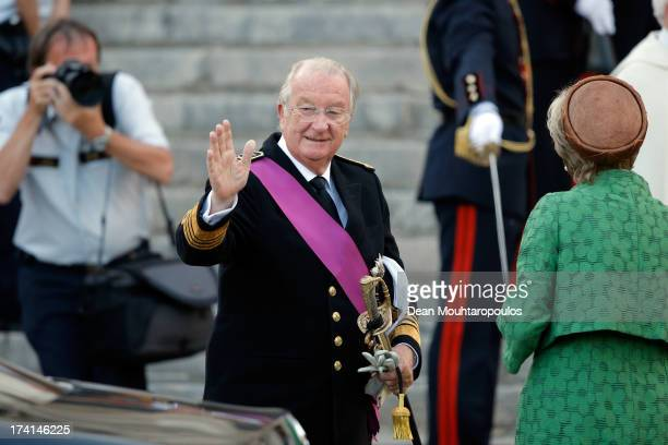 Queen Paola and King Albert II of Belgium are seen in front of the Cathedral of St Michael and Saint Gudula prior to the Abdication Of King Albert II...