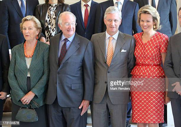 Queen Paola King Albert Prince Philippe and Princess Mathilde of Belgium receive members of COMORI at Laeken Castle on July 8 2013 in Brussels Belgium