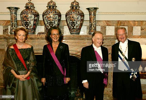 Queen Paola Maria Jose Ritta Portuguese President Jorge Sampaio and King Albert pose before the gala dinner at Laeken Castle October 18 2005 in...