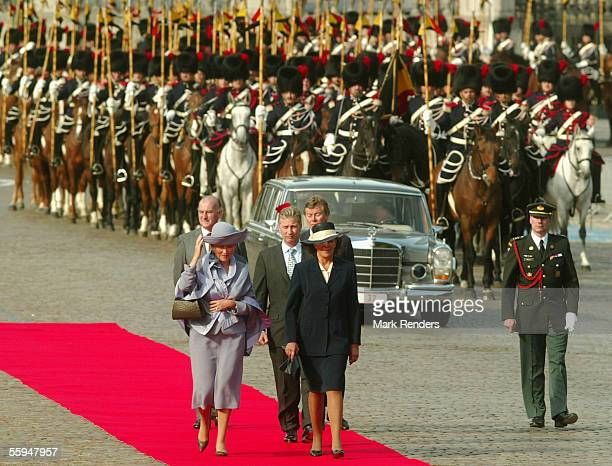 Queen Paola Mrs Maria Jose Ritta and Prince Philippe assist the official welcome ceremony at the Place Des Palais on October 18 2005 in Brussels The...