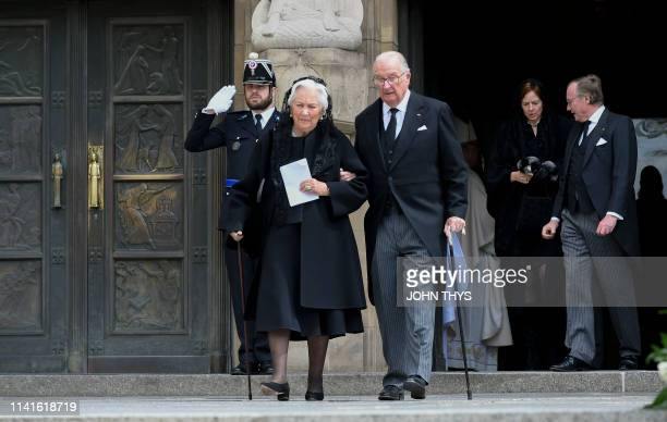 Queen Paola of Belgium and King Albert II of Belgium leave the NotreDame Cathedral after the funeral ceremony for Jean d'Aviano Grand Duke of...