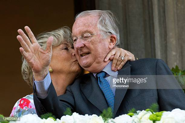 Queen Paola of Belgium kisses King Albert of Belgium during their last official visit as King and Queen of Belgium on July 19 2013 in Liege Belgium
