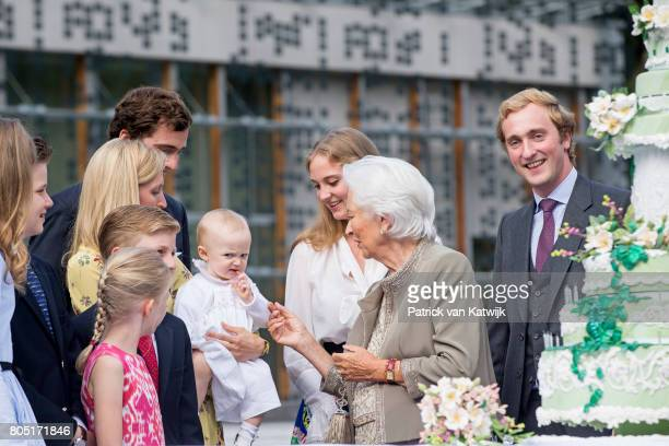 Queen Paola with her grand children Crown Princess Elisabeth Prince Gabriel Prince Emmanuel Princess Eleonore Prince Amedeo with his wife Lili and...